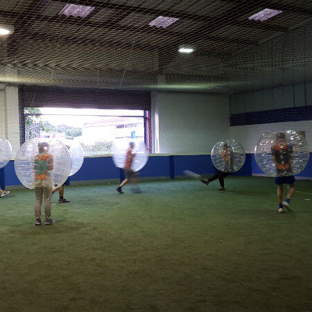 team social playing bubble football
